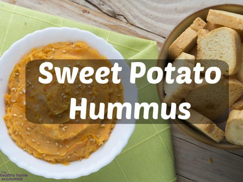 sweet potato hummus in a white bowl on a green napkin