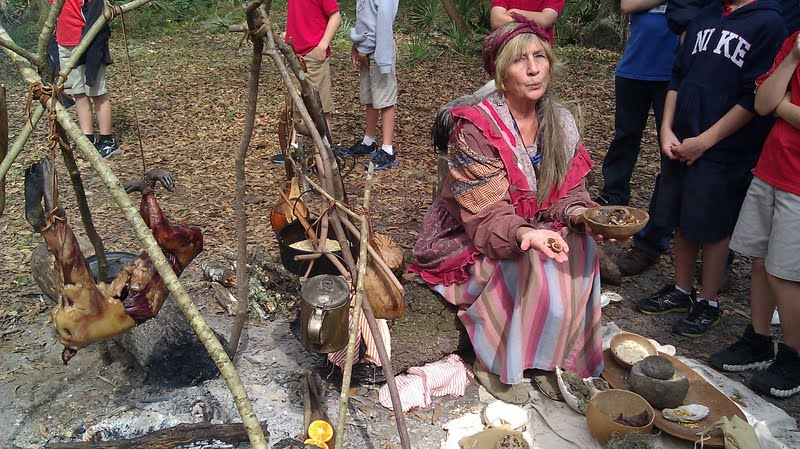 seminole tribe members preparing a meal over a fire