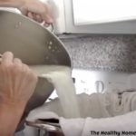 pouring ricotta and whey into colander