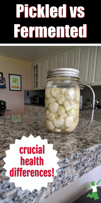 fermented garlic in a jar on the counter