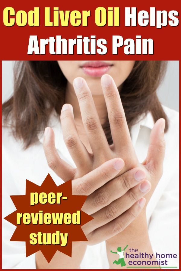 woman taking cod liver oil with arthritis in her left hand