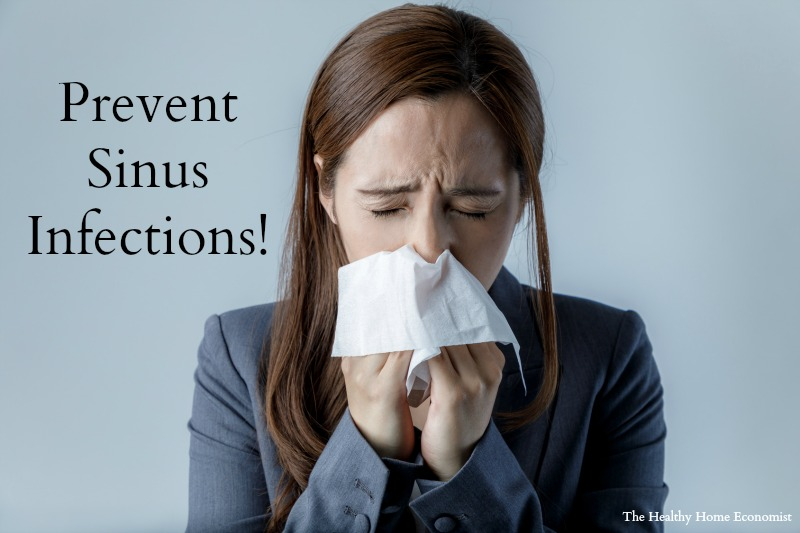 woman trying to prevent sinus congestion blowing her nose