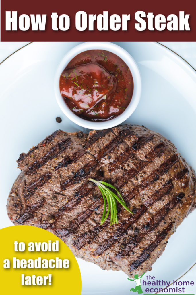 well done steak on a white plate with sauce