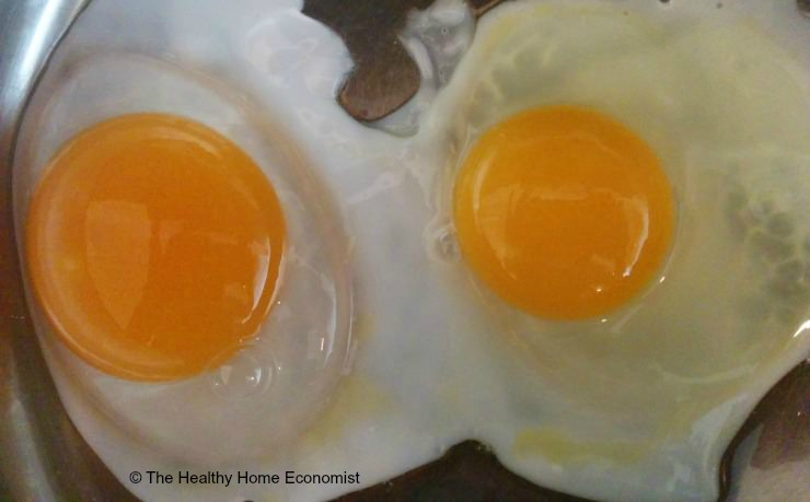 duck egg and chicken egg cooking in pan