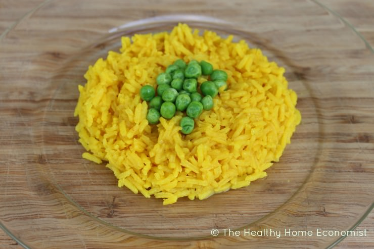 yellow rice topped with peas