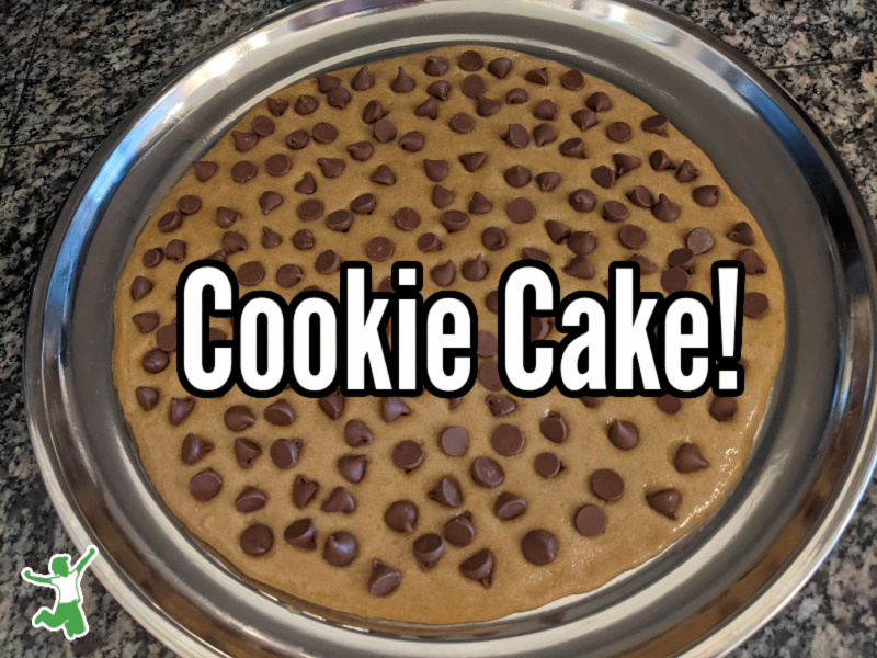 chocolate chip cookie cake batter on a pizza pan