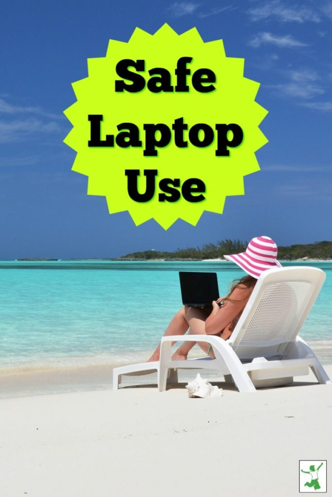 woman using a laptop in a chair at the beach