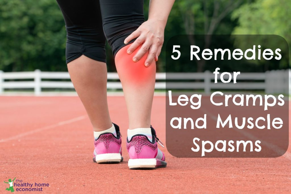 woman experiencing a painful leg cramp while exercising