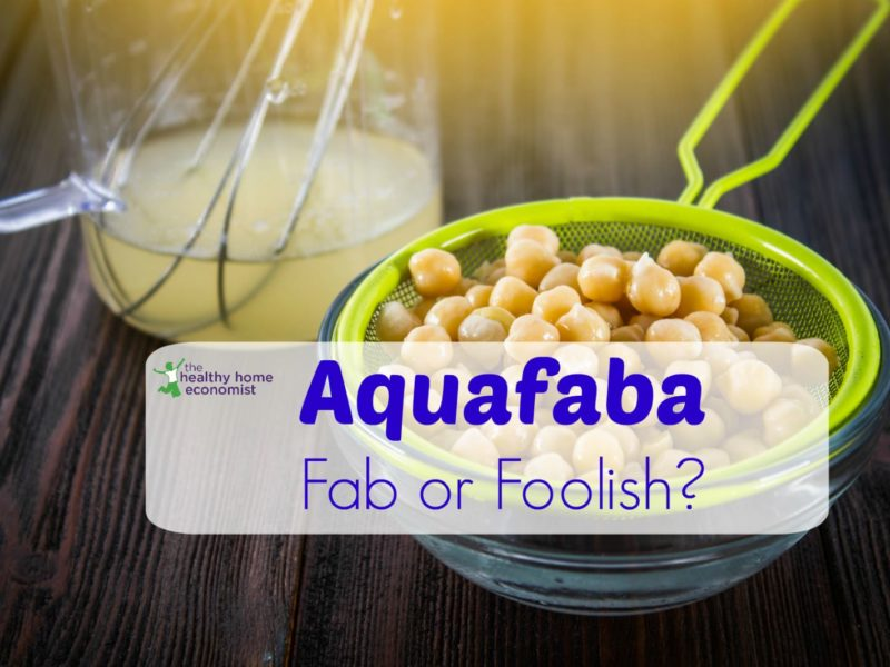 aquafaba in a glass jar with a bowl of strained chickpeas