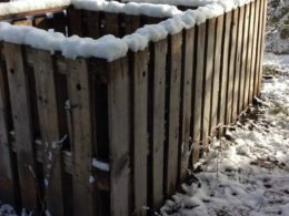 homemade compost bin rimmed with newly fallen snow