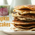 stack of low carb keto pumpkin pancakes on a white plate