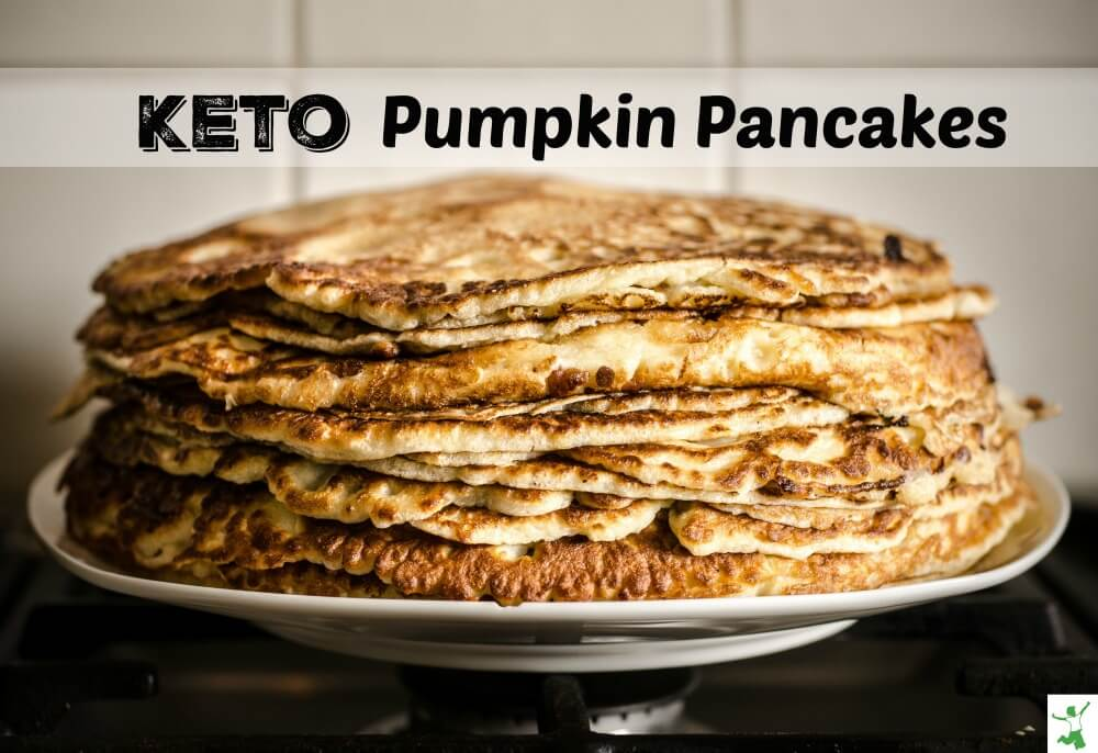 keto pumpkin pancakes stacked on a plate