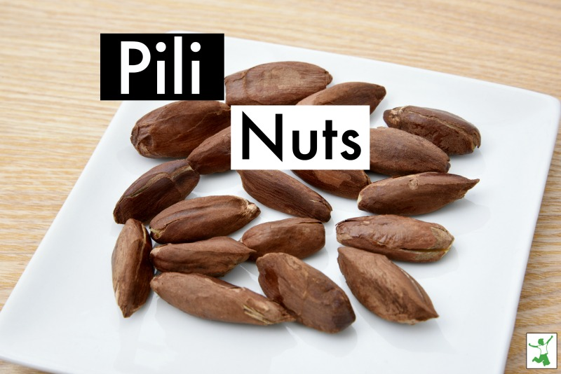 pili nuts on a white plate