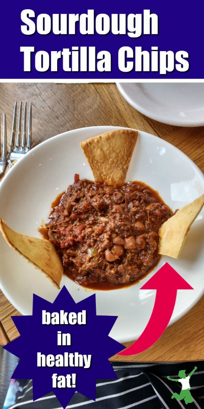 homemade tortilla chips in a bowl of chili