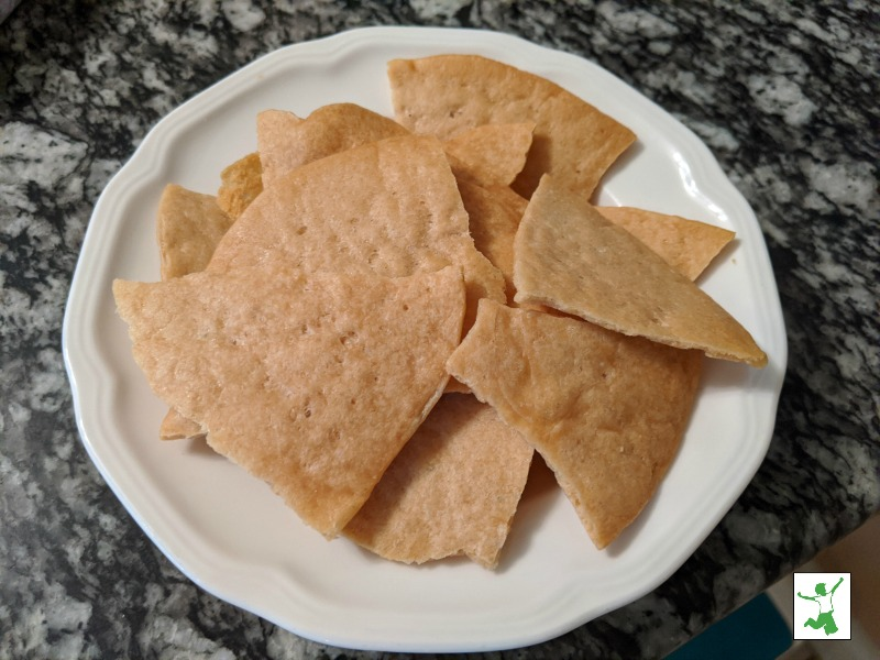baked sourdough tortilla chips in a white bowl