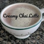 chai latte with foam on top in a mug