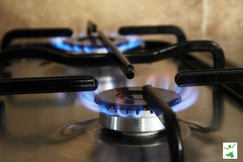 gas cooktop with two lit burners