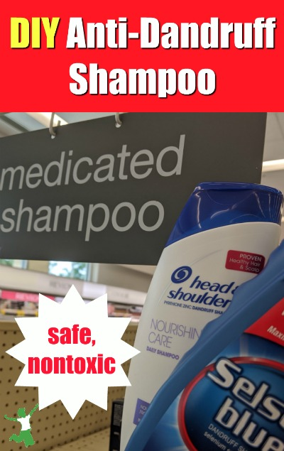 bottles of dandruff shampoo in a woman's hand