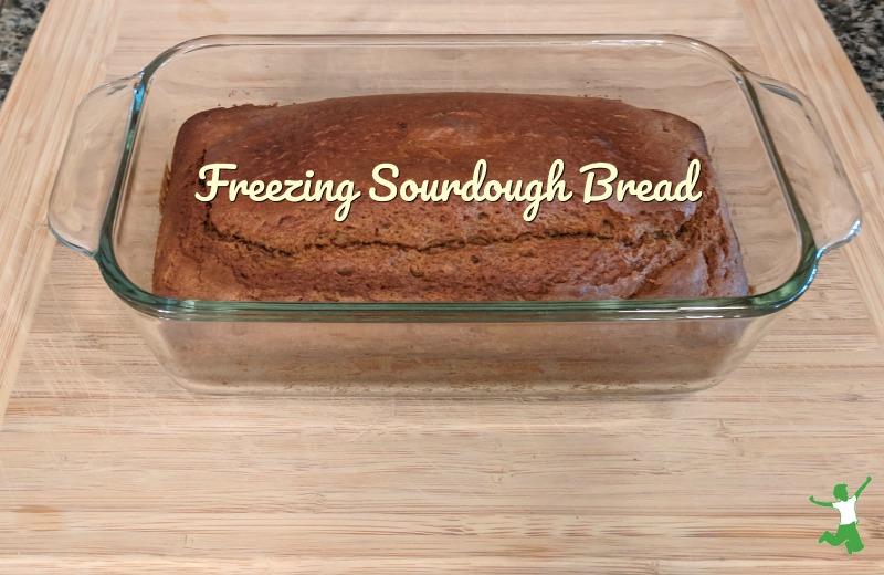loaf of frozen sourdough on a breadboard