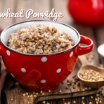 buckwheat porridge in a bowl on a wooden table