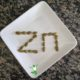 pumpkin seeds arranged in the word zinc on a plate
