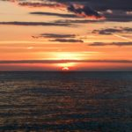 red light of sunset on the ocean