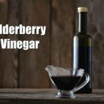 elderberry vinegar in a bottle on a wooden counter