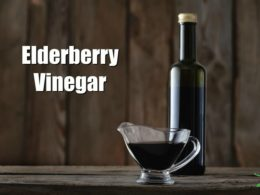 elderberry vinegar in a bottle on a wooden counter