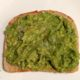 easy slice of avocado toast on a white plate