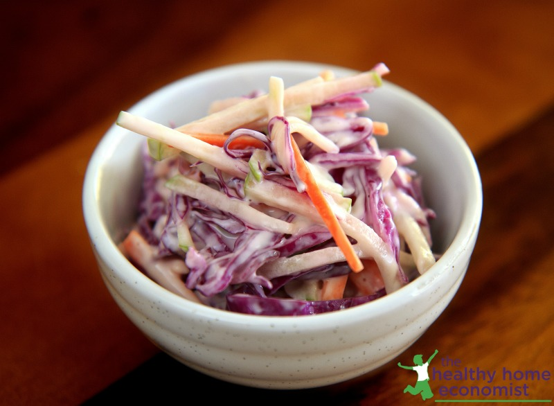 homemade coleslaw in a white ceramic cup