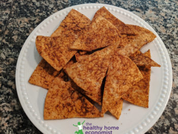 dorito-style chips on a plate on granite countertop
