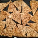 homemade taco doritos on a baking sheet