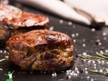 grassfed filet mignon steak on a dark background