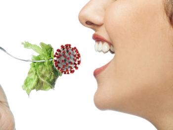 woman taking a bite of mRNA salad