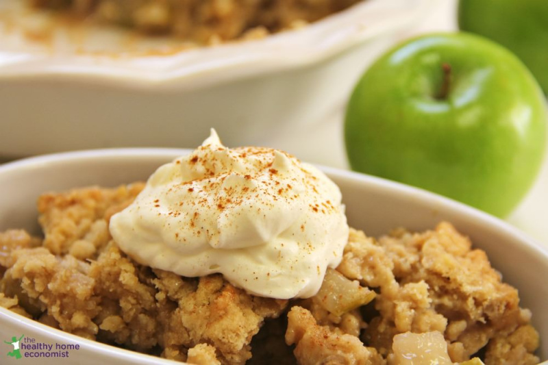 grain free apple cobbler with nondairy topping in a white dish
